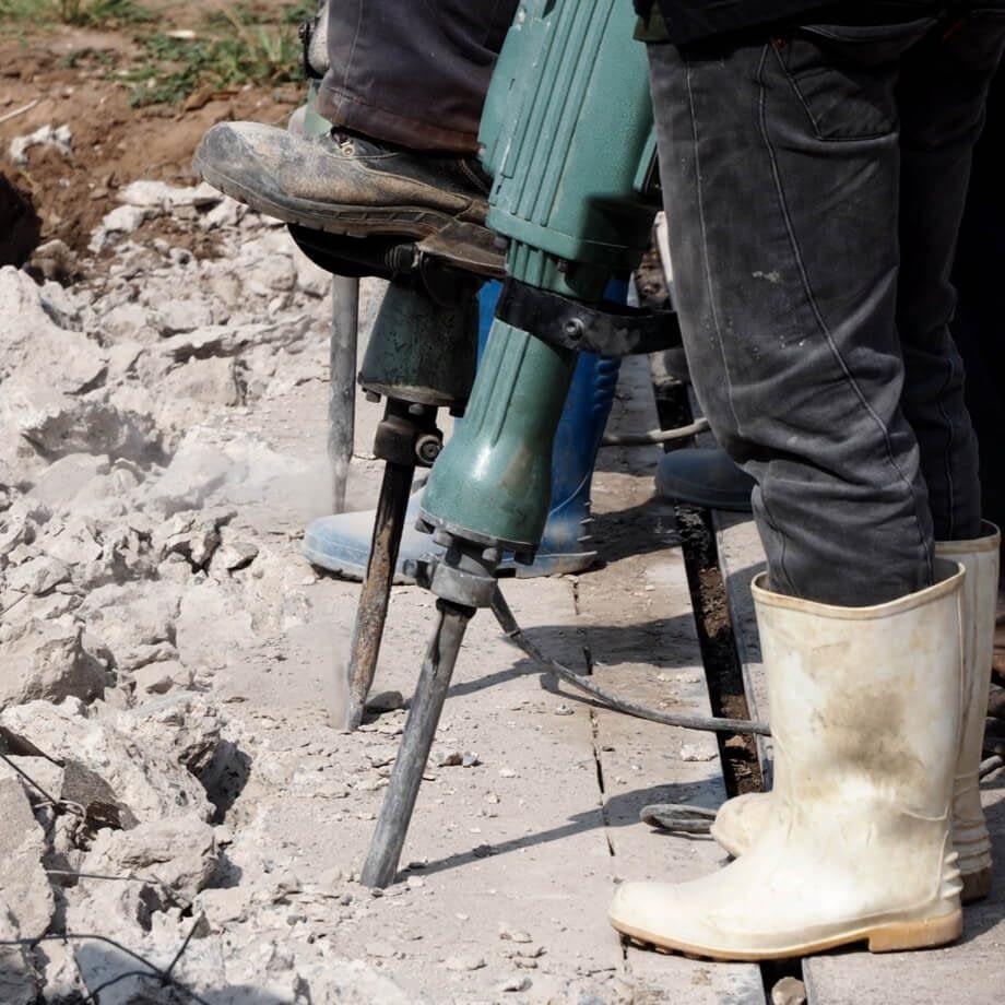 construction workers at concrete demolition site in colorado springs