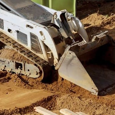 bulldozer moving earth at a project site